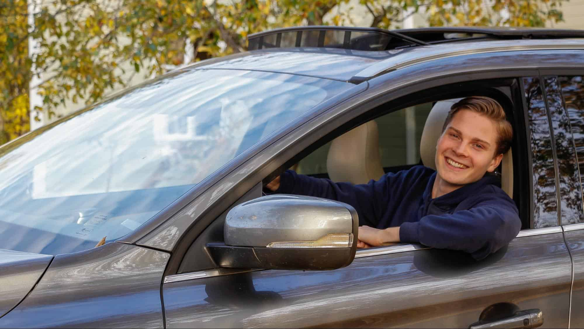 student driver looking through car window
