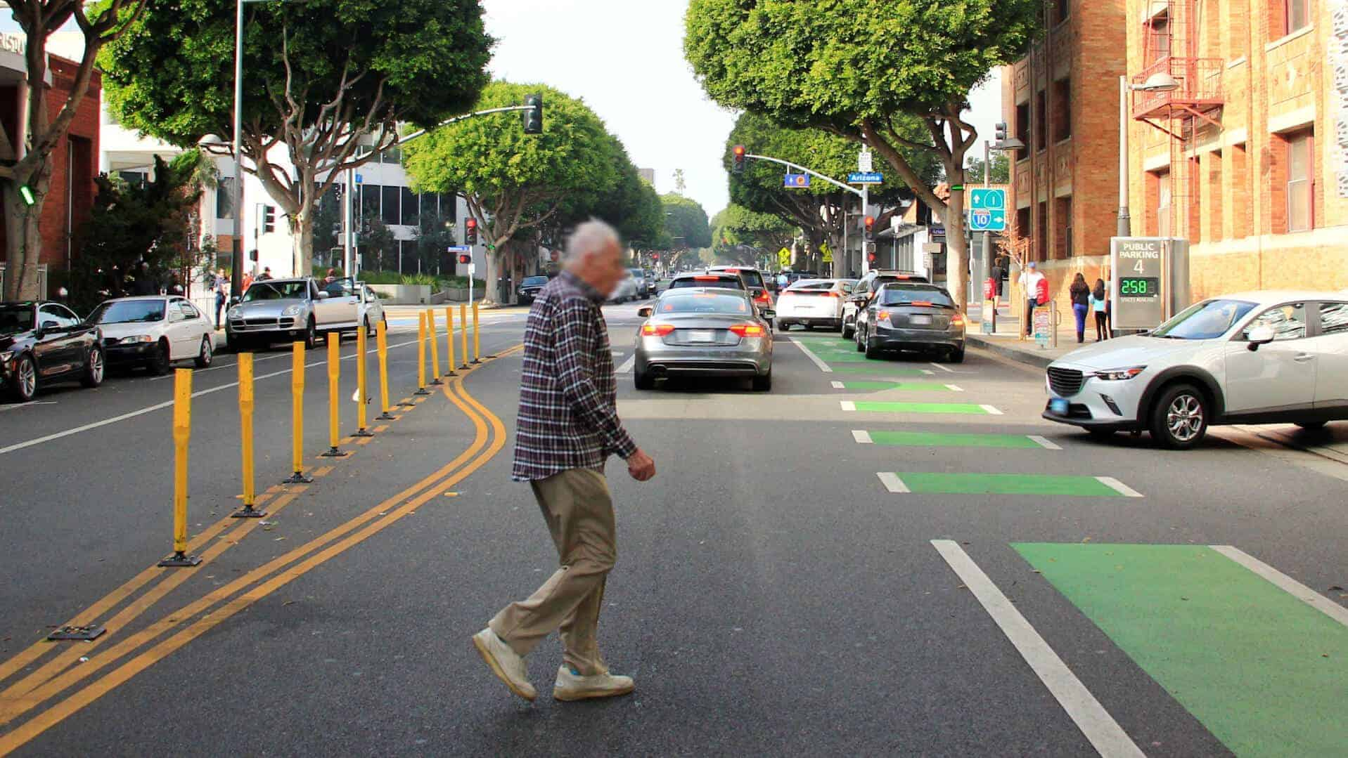 Elderly pedestrian crossing the street at an at an unsuitable crossing point