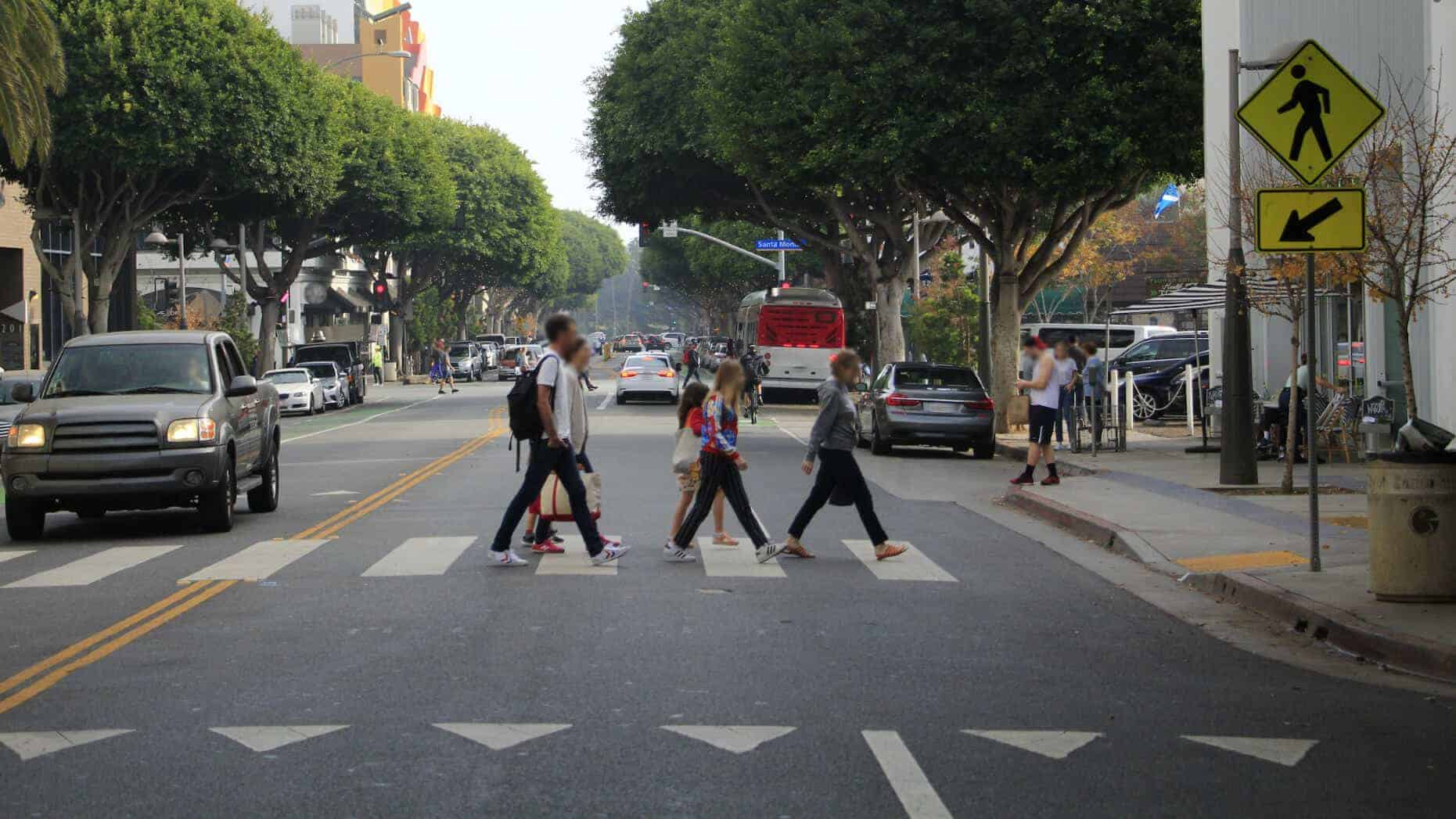 A group of young people at a marked crosswalk