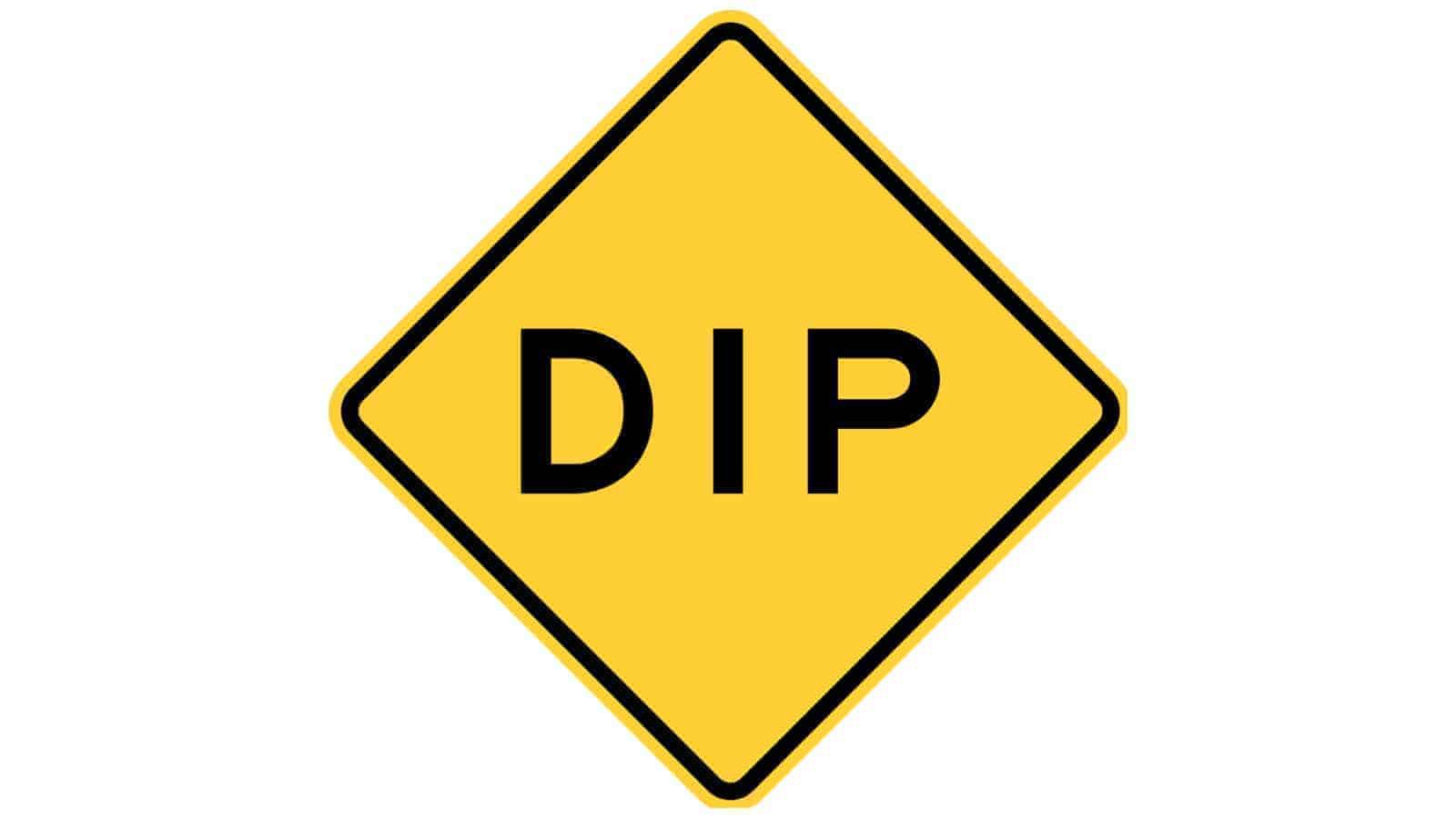 Warning sign Dip Ahead